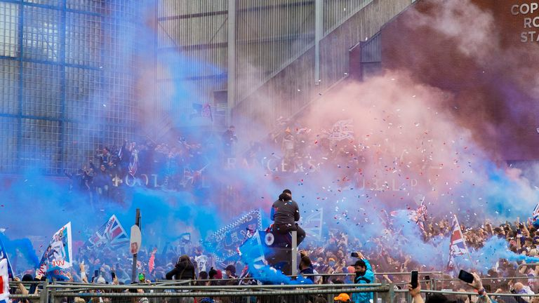 rangers fans celebrate outside ibrox