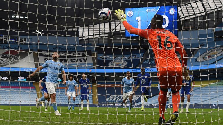 chelsea's goalkeeper edouard mendy saves a penalty shot by manchester city's sergio aguero, left, during the english premier league soccer match between manchester city and chelsea at the etihad stadium in manchester, saturday, may 8, 2021.