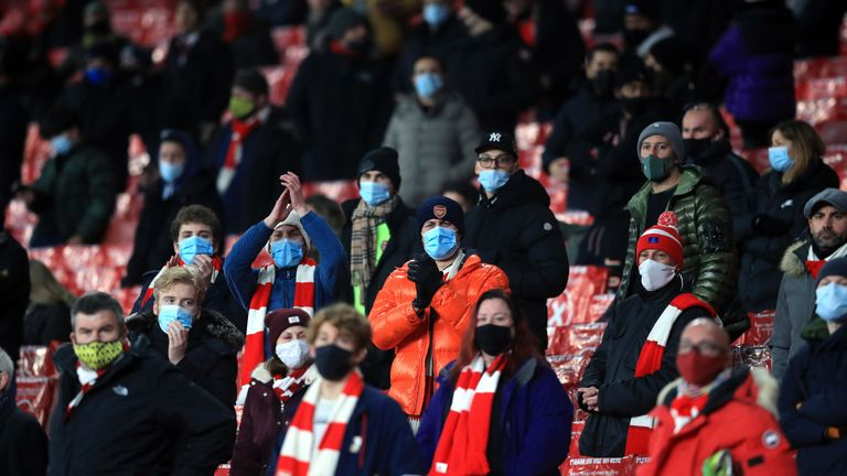 socially distanced fans in the stands at arsenal's emirates stadium