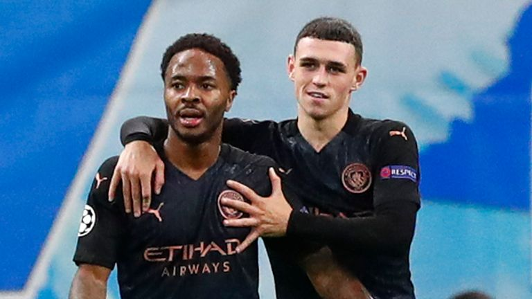 manchester city's raheem sterling, second left, is congratulated by teammate phil foden after scoring his team's third goal during the champions league group c soccer match between marseille and manchester city at stade velodrome in marseille, france, tuesday, oct. 27, 2020. (guillaume horcajuelo/pool via ap)