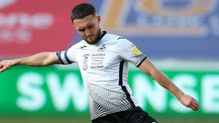 swansea city captain matt grimes has called the recent abuse that his team-mates have suffered as 'sickening and vile'